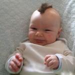 Нужно ли стричь малыша до года?